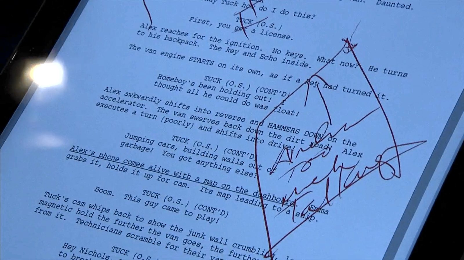 Two lines in the script have red crosses drawn over them, and a box with an arrow encloses a comment on a specific passage.