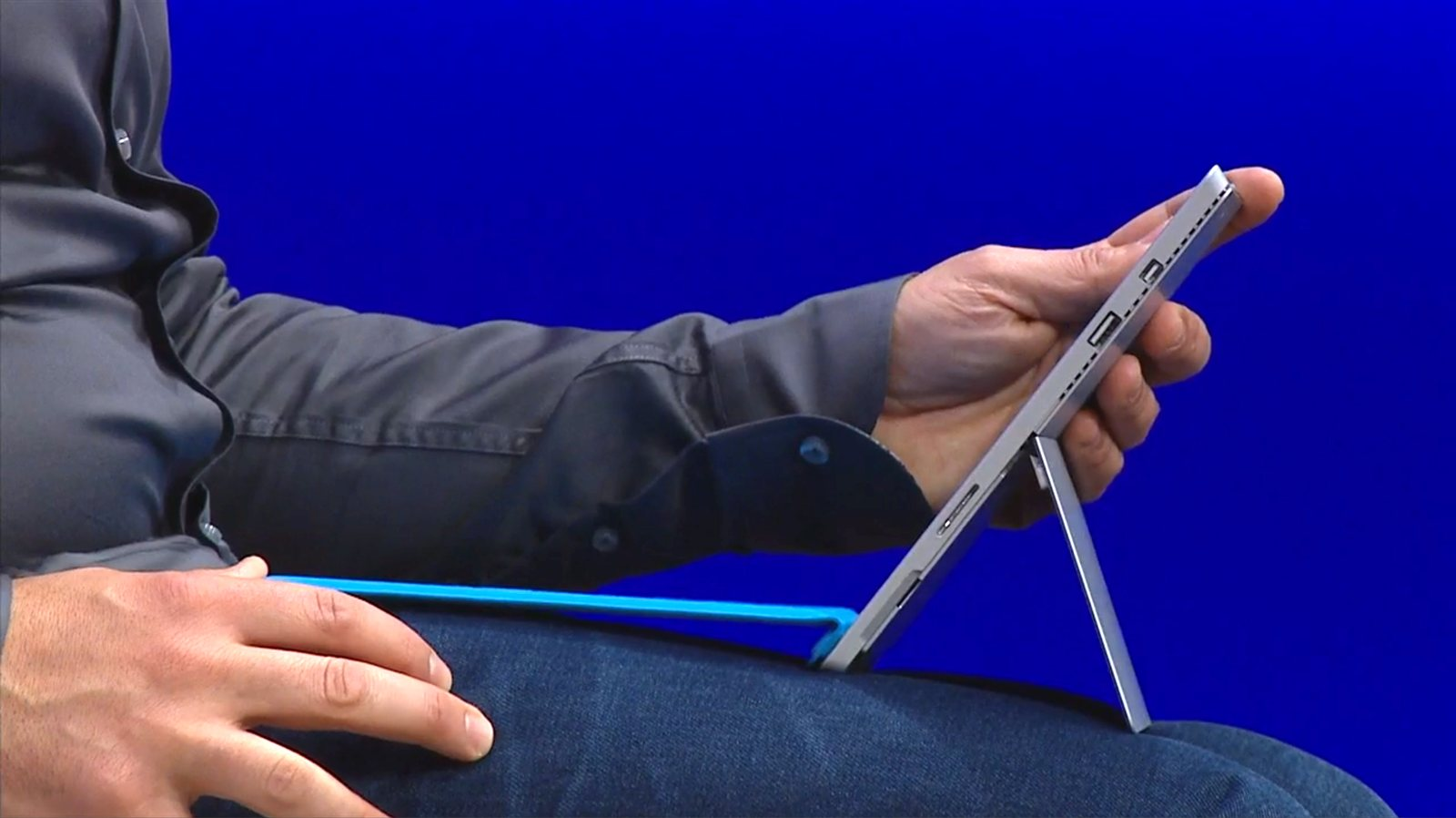 Panos Panay clicks the keyboard cover onto the front of the Surface Pro 3 to increase stability.